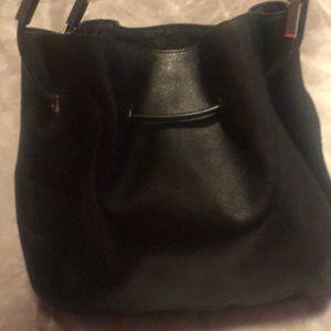 Like New black leather Gucci purse